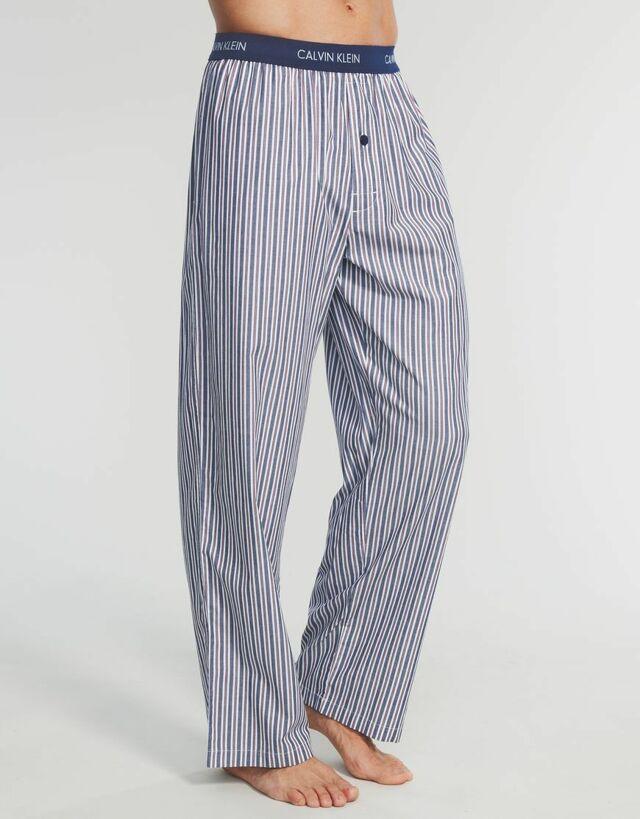 Kalhoty dlouhé  U1197A - Calvin Klein