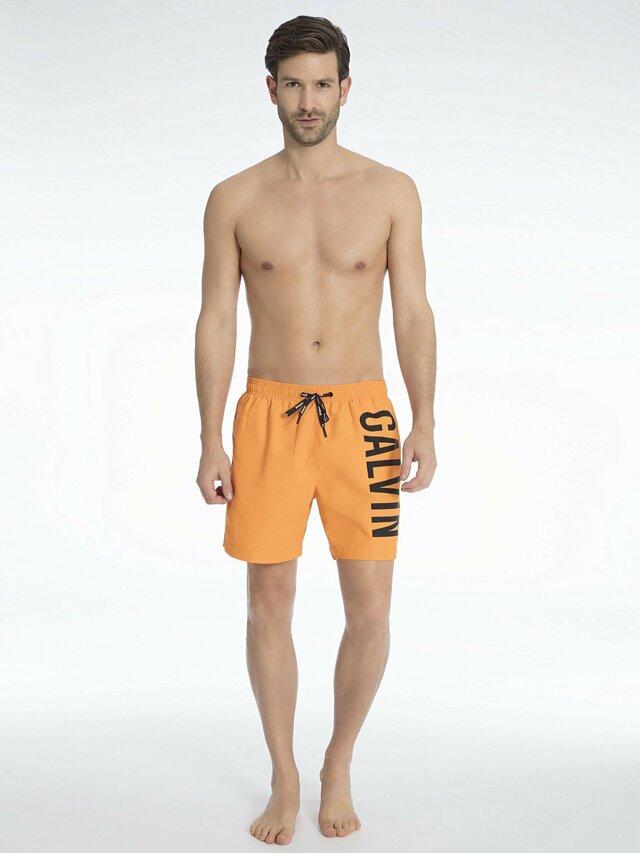 Pánské plavky KM0KM00150-803 oranžová - Calvin Klein